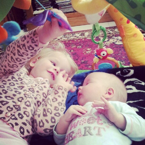 "Lexi teaching her baby sister. ""butterfly"" (Taken with Instagram)"