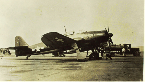 A captured Aichi B7A Ryusei (Grace) Navy Type 94 Carrier Bomber undergoing servicing by American ground crew