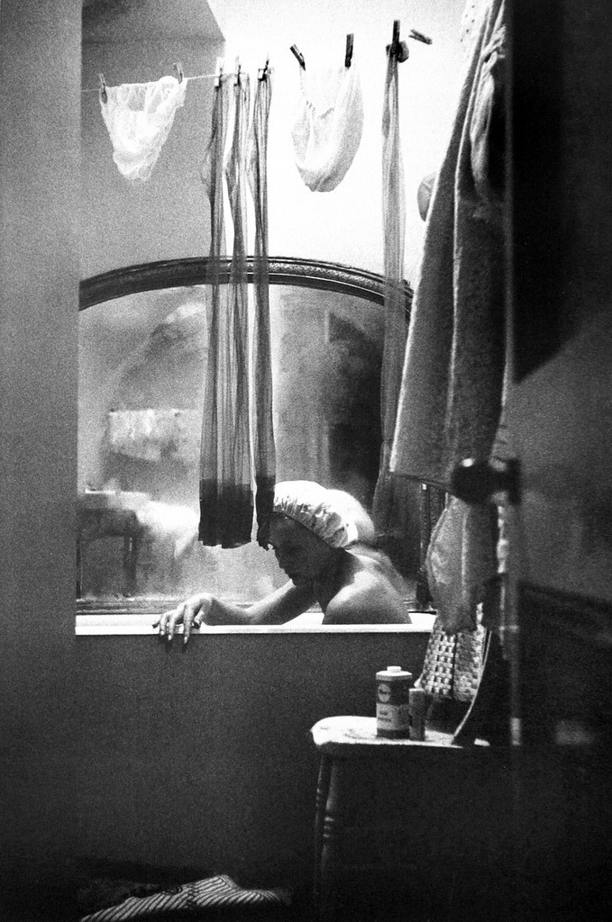 undr:  Eve Arnold A girl who shares a bath and flat with three other girls, London, 1961  Haven't seen this photograph in 20 years.