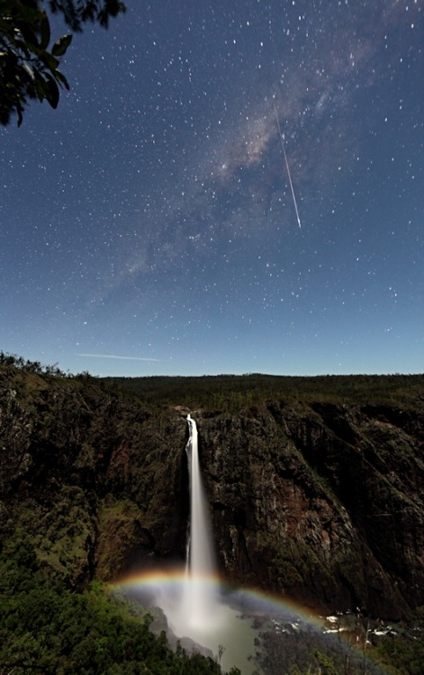 Meteor & Milky Way above Waterfall & Moonbow  A night at Wallaman Falls, Queensland, Australia. A bright meteor crosses the Milky Way, while the light of the gibbous Moon causes a moonbow with the waterfall.