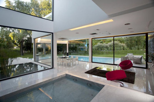 Indoor pool and water features at living room provides cool home interior