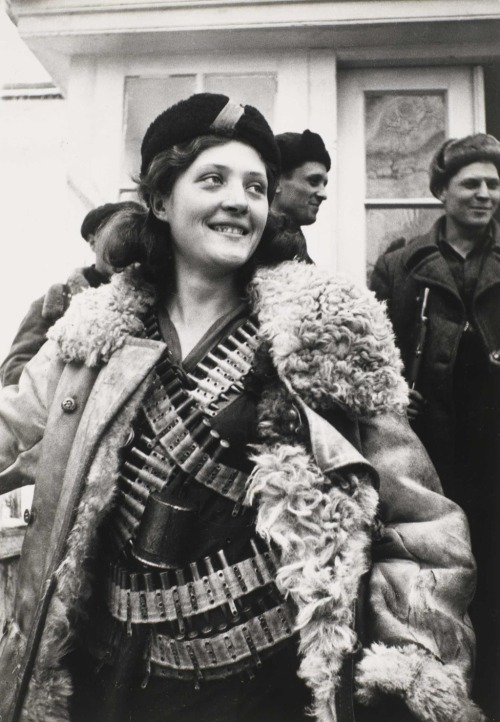 Female partisan, 1942. Photo by Arkady Shaikhet.