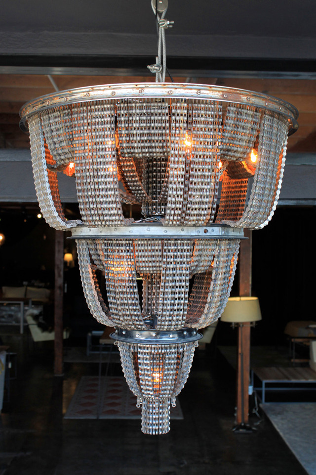 Carolina Fontoura Alzaga makes chandeliers out of old bicycle parts. Fiscally sound. See how >