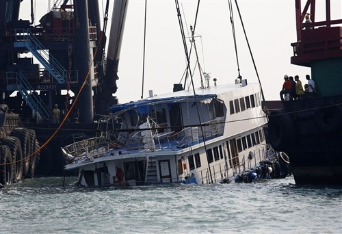 Six crew members arrested after Hong Kong boat collision kills 37 (Photo: Vincent Yu / AP) Police on Tuesday arrested six crew members from two boats carrying partygoers that collided, killing at least 37 people in one of Hong Kong's deadliest maritime accidents. Police Commissioner Tsang Wai-hung said crew members from both boats were detained on suspicion of endangering passengers by operating the craft unsafely, but he provided no other details, The Associated Press reported. Read the complete story.