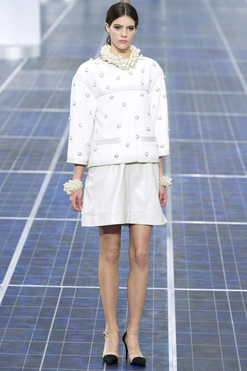 "Chanel S/S 2013 With wind turbines lining the length of the Chanel catwalk this morning, Karl Lagerfeld said the collection is ""more about the mood of the times, not something you have to translate. It's all about wind, it's in the air. """