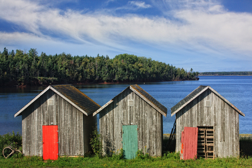 travelingcolors:  Three Shacks, One New, Red Door, Prince Edward Island | Canada (by Amanda White)