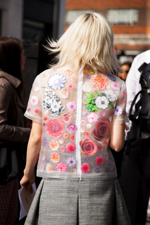 How great is this sheer silky top with flower applique on it?