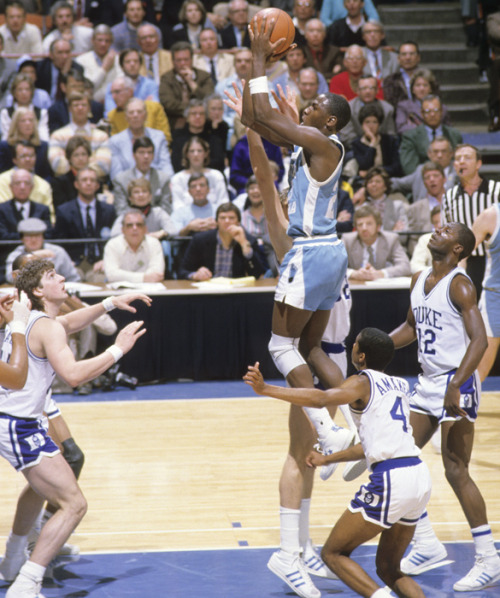 siphotos:  North Carolina guard Michael Jordan drives through the lane amongst a sea of Duke defenders during a 1984 game between the Tar Heels and Blue Devils. Jordan won the Naismith and the Wooden College Player of the Year awards in 1984 before being drafted by the Bulls with the third overall pick. (Heinz Kluetmeier/SI) GALLERY: Duke-UNC Classic Photos | Michael Jordan in College