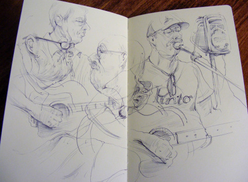 eatsleepdraw:   A sketch from a recent Friday night music thing at a local coffee shop/book store. Wish I could have stayed longer to listen and draw as these two guitarists were simply amazing!