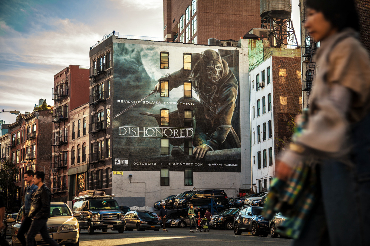 Giant Dishonored painted ad on Lafayette & Prince in Soho