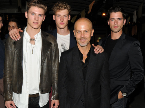 Calvin Klein Collection's Men's Creative Director, Italo Zucchelli, surrounded by the boys – Mikkel Jensen, Joel Meacock and Sean O'Pry – at the ENCOUNTER Calvin Klein fragrance launch party.  ©2012 Billy Farrell/BFAnyc.com