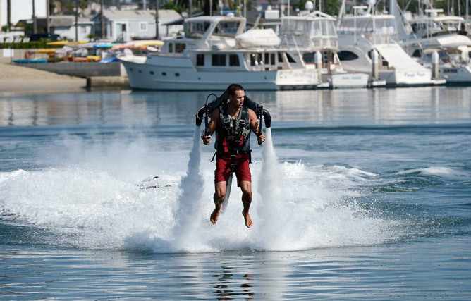 Photo caption contest: Like a jetpack over troubled water? Each week, we post a photograph from the news, and we invite readers to write their own captions (click on the comment link at left). We'll choose our favorite captions at the end of the week and publish them in The Sunday Denver Post. Head over to the Idea Log to submit your caption entries.