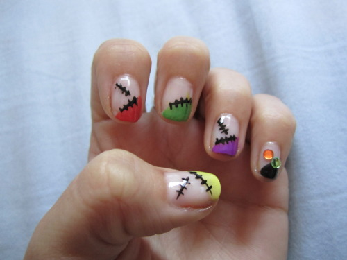 rhea46:  Halloween french tip patchwork nails. Found this design online, and it was just TOO pretty to alter.  The original design had a smaller design on both green fingers. I opted away from it as this was just amazingly cool looking.