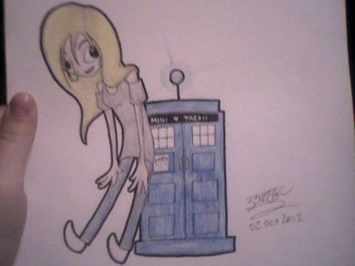 Found my Doctor Who DVD's today. Had me a marathon. Drew Rose with a Mini TARDIS. Everything is good. Bad quality pic. Too lazy to get up and use the scanner haha