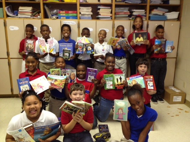 "OUR FIRST SUCCESS STORY!   The very first wish list filled, 221 books, went to Southside Elementary.  Their library had no books for fourth graders.  None.  Listen to what's happening now… ""Southside Elementary School was bombarded with boxes and boxes of fabulous books today. The poor UPS guy didn't know what to think as he hauled them in on the dolly. Our students were very excited and could not contain themselves as I opened boxes and showed them each book. The 'oohs and aahs' were heard all around as excitement filled the air. One student wanted to know if it was my birthday. LOL! I then explained how wonderful people across the nation had so much faith in them they wanted to make sure they had plenty of great books to read! I read the notes that came from the gifters and with eyes wide, the students would repeat the state the sender was from in awe. They couldn't believe this many people cared enough to bless them with so many books and they can't wait until the books are logged, labeled and ready to read! Thank you to everyone who has made this happen for my students and our school."" Help us make more book magic happen!  See our current wish lists for more books still waiting to head to a school in need."