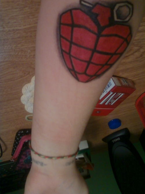 My brand spanking new heat grenade tattoo, along with my ♥80-  -BJA♥ tattoo on my wrist(which is very hard to make out in this picture).  - Done by Chris at Straight Edge in Murfreesboro, TN - I cannot honestly tell you guys how important Green Day, and Billie Joe Armstrong especially, means to me. They are my heart and soul, they are attached to my very being. I will love these goofy bastards until the day I die, and nothing will ever change that. Thank you Billie, Mike, and Tre.  I am so excited to start my beautiful Green Day sleeve.