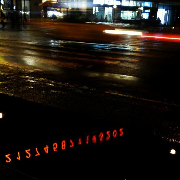 Back to the future. I love the metronome installation in Union Square and the reflection in the puddle def caught my eye. Fun fact, it rained the day I was born, my grandmother said that when that happens rain follows you throughout your life. It truly has rained on every important day in my life/if I had something going on. So it makes sense that it rained today! - posted in NYCbaton's instagram account. http://instagr.am/p/QTidosO2bM/
