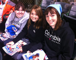 Michelle (middle) tweeted to @Cubs about her friends Tayler and Alisha attending their first game. They were surprised with gifts in their seats!