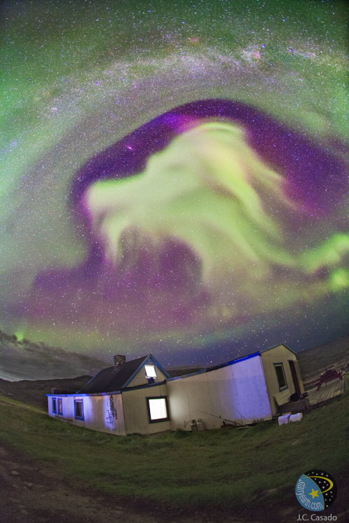 ikenbot:  Goat Aurora Over Greenland  Sometimes it's hard to believe what you see in the sky. During the Shelios Expedition to Greenland in late August, even veteran sky enthusiasts saw auroras so colorful, so fast changing, and so unusual in form that they could remember nothing like it.  Image Credit & Copyright: Juan Carlos Casado (TWAN)  As the ever changing auroras evolved, huge shapes spread across the sky morphed from one familiar form into another, including what looked to be the head of a goat (shown above), the head of an elephant, a strange green-tailed comet, and fingers on a celestial hand.  Even without the aurora, the sky would be notable for the arching band of our Milky Way Galaxy and the interesting field of stars, nebulas, and galaxies. In contrast, in the foreground is a farm house in Tasiusaq, Kujalleq. Greenland. The Shelios project exists not only to observe auroras but to motivate students to consider a career in science.