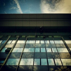 Just hanging around … the clouds #windowwasher #building #glass #clouds #reflection (Taken with Instagram)
