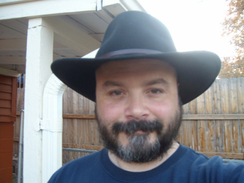 "I've Grown Partial to This HatThis is me yesterday out in my yard. Good god, I love Fall. I'm outside a lot. Basically, I'm out in the yard and every once in a while I'll run into the house, post something brilliant on the internet, then run back out.Like I said in the title, I've grown partial to this hat. I feel kind of naked without it. I wear it everywhere: to bed, in the shower, while line dancing alone in my sad, little apartment—everywhere. The only time I take it off is when I masturbate, because keeping it on then would be just plain rude.Manners, people!The best book I read in the last 30 days was The Journal of George Fox. The Journal of George Fox is the ""spiritual autobiography"" of the dude who started the Quakers back in the 1600s. He was the Original Quaka (OQ). Starting a brand new (and very liberal, let's not forget) view of Christianity got him into pretty much constant shit. He was always being run out of towns and getting thrown into slammers—just for thinkin' and sayin' different.One time, after he pissed off a bunch of stuck-in-the-muds, he got his ass kicked. He described it as ""an extensive pummeling"".Indeed.During the skirmish, he lost his hat, and according to him, ""never had it again"".How can that be? I wondered. If I was getting my ass kicked by a bunch of Michele Bachmann types and my hat fell off, I'd go back and get that sumbitch. Count on it.That was the only part of the book where I didn't admire George Fox.Priorities, George. Come on!"
