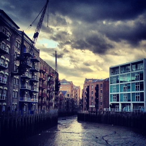 Channel • #stsavioursdock #shadthames #inlet #riverthames #bermondsey #london #londondocklands #england #greatbritain #unitedkingdom #dockside #warehouses #apartments #balconies #brick #glass #wood #greycloud #sun #mud #crane #autumn #afternoon #september #2012 #xproII #lux #st #thest (Taken with Instagram at Saint Saviour's Wharf)