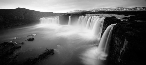 Waterfall Of The Gods by jamescharlick on Flickr.Via Flickr: The Goðafoss is one of the most spectacular waterfalls in Iceland. The water of the river Skjálfandafljót falls from a height of 12 meters over a width of 30 meters. Named after the waterfall was MS Goðafoss, an Icelandic ship carrying both freight and passengers, that was sunk by a German U-Boat in World War II, resulting in great loss of lives. This is a panoramic merge of 4 photos, each of which are 10 second exposures, f5.6, 11mm. Press L to view on black.website  |  etsy  |  500px  |  tumblr