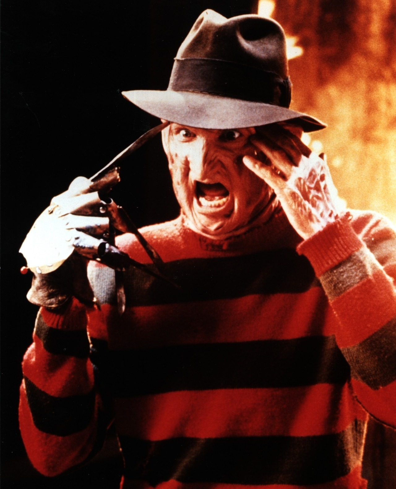 FREDDY KRUEGER Freddy's sweater was described as red and yellow in the script and the idea was that whatever Freddy changed into would be yellow and red as well. Wes Craven later changed the colors to red and green, the two most contrasting colors to the human retina. A Nightmare on Elm Street (1984), directed by: Wes Craven, costume design by: Dana Lyman