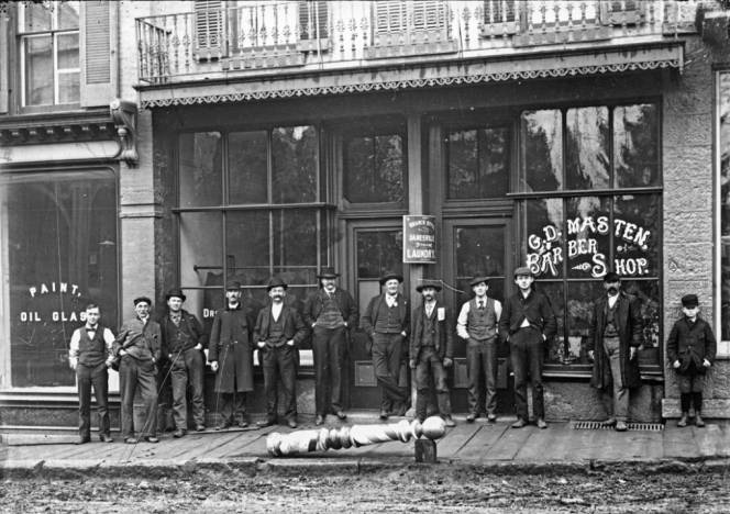 G. D. Masten barber shop, Mineral Point, Wisconsin, 1880-1910. This barber shop (on the right) shared a storefront on Mineral Point's High Street with Dr. John Vivian and sons (on the left). via: Mineral Point Historical Society