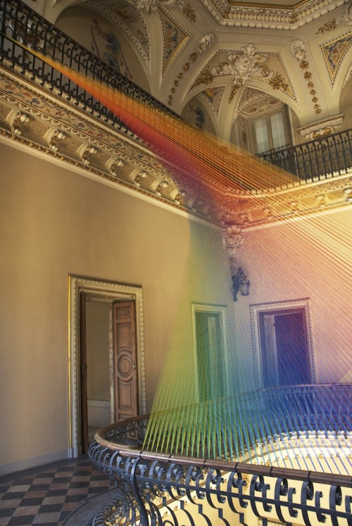 "mydarkenedeyes:  First look: Gabriel Dawe's stunning new thread art in Italy. Gabriel Dawe created Plexis no. 19, a stunning thread installation thats beautifully spread across two balconies in the atrium of a historic villa. The early 19th century neoclassic house, called Villa Olmo, was acquired in 1924 by the municipality of Como and is now open to the public only during cultural events and art exhibitions like this. Plexus no. 19 consists of two thread structures streamed across an upper and lower balcony that is meant to be experienced from different angles or at different times of the day. As Dawe tells us, ""When the sun comes in during the morning, it is fantastic. Having those window-shaped light beams add a dimension to the installation. I always like when I get direct sunshine on them because it emphasizes the layering of the thread in very interesting ways."" With two assistants, he constructed this installation in about a week. His greatest challenge was working to the confines of the space. ""Because of the historic nature of the building, I wasn't able to touch ceiling, walls or floors to screw in my structures,"" he says. ""So I resorted to fixing them to the railings, which in great measure restricted what I was able to do. In the end, it worked out pretty well; it really exceeded my expectations how well the installation inhabits the space."" Via My Modern Met."