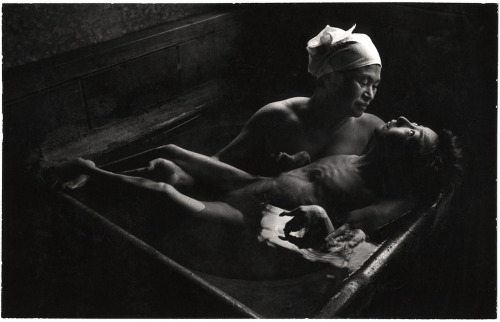 "© William Eugene Smith, 1972, Tomoko and Ryoko Uemura This photo is part of Silfarione's series ""20 Most Powerful Photographs Ever Taken."" Go check it out on her blog - it's one of the best blogs here on Tumblr btw!I mentioned this photograph before when talking about Samuel Aranda's famous Yemen picture that won a World Press Photo Award. Read the whole story here.  W. Eugene Smith took a dramatic photograph of Ryoko Uemura, holding her severely deformed daughter, Tomoko, in a Japanese bath. Both Tomoko and Ryoko were poisoned by the release of methyl mercury in the industrial wastewater from the Chisso Corporation's chemical factory from 1932 to 1968, called Minamata disease. Tomoko was poisoned while still in the womb and she died in 1977 at the age of 21.  For his expose of this photograph, Smith was attacked and injured by Chisso employees which left him with a permanently damaged eye and a crippled health. The photos, however, led the government to take more direct actions and the company to pay compensation to 2,500 people.   (thanks to / via: silfarione)"
