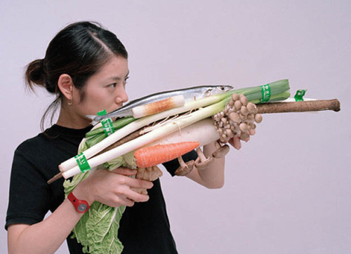 Photos of Women Holding Vegetables as Weapons