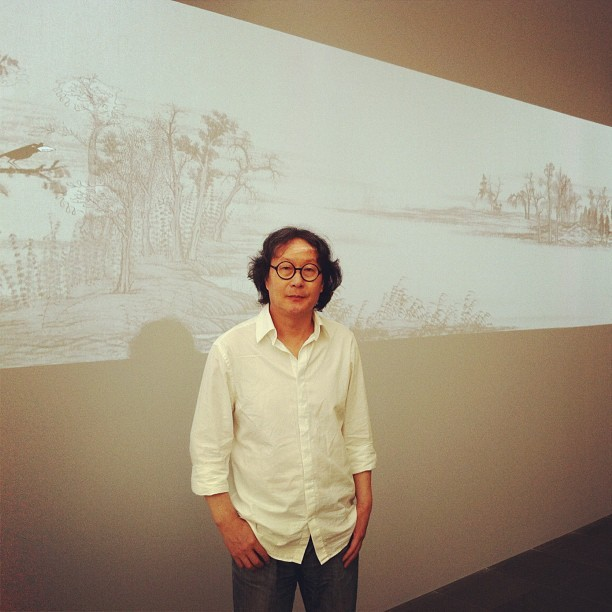 "Xu Bing in front of his epic animation ""The Character of Characters,"" in our #calligraphy show. It's amazing. (Taken with Instagram) This world-renowned highly acclaimed artist will be speaking at the museum tomorrow night (Thursday) with Jerry Yang. Details here."