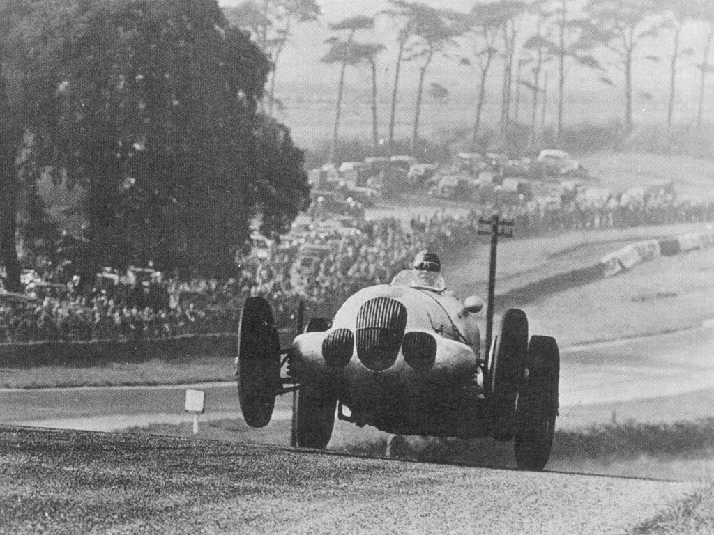 Manfred von Brauchitsch gets airborne with his Mercedes-Benz W125 in the Donington GP, 1937. The Grand Prix racing car designed by Rudolf Uhlenhaut to race during the 1937 Grand Prix season. The car was used by Rudolf Caracciola to win the 1937 European Championship and W125 drivers also finished in the second, third and fourth positions in the championship. The supercharged engine, with 8 cylinders in line and 5,662cc, attained an output of up to 595 horse power (444 kW) in race trim. The highest test bed power measured was 637 BHP (646 PS) at 5,800 rpm. The W125 was considered the most powerful race car ever for about 3 decades, until large capacity US-built V8 engines in CanAm sportcars reached similar power in the mid 1960s. In Formula One racing itself, the figure was not exceeded until the early 1980s, with the appearance of turbo-charged engines in Formula One. The W125 reached race speeds of well over 300 km/h (190 mph) in 1937, especially on the AVUS in Berlin, equipped with a streamlined body. In land speed record runs, a Mercedes-Benz W125 Rekordwagen was clocked at 432.7 km/h (268.9 mph) over a mile and a kilometer. This car was fitted with a DAB V12 engine (82.0 x 88 mm) of 5,576.75 cc (340.31 CID) with a power of 726 BHP (736 PS) at 5,800 rpm. The weight of this engine caused the car to weigh over the 750 kg maximum limit, so it never appeared in Grand Prix.