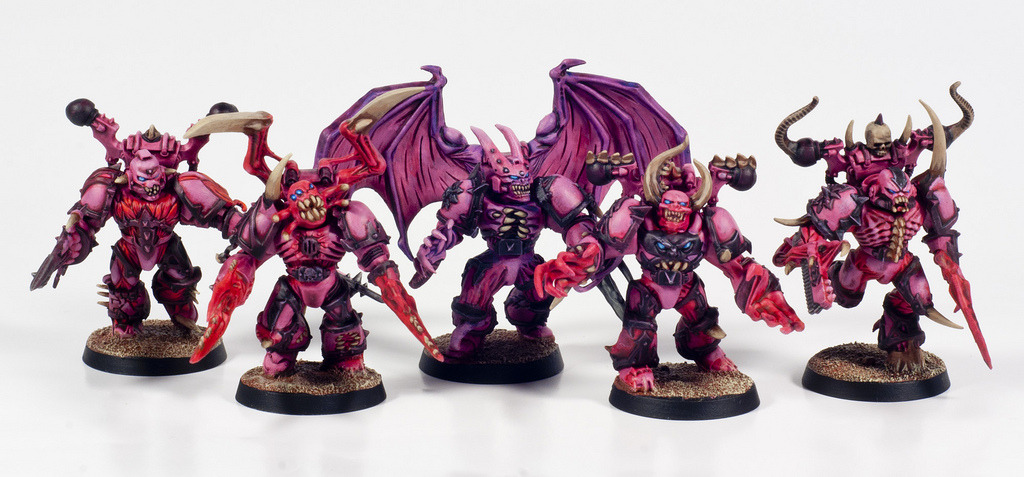 Possessed Chaos Space Marines. Painted on commission as part of an Angels of Ecstasy army.