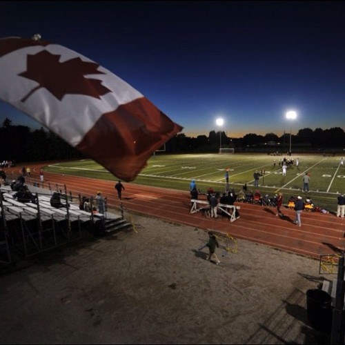The Canadian flag flutters in the breeze during a Burlington Minor Football Association game between the Argonauts and Ti Cats on Sept 24 2012. (Fred Lum/The Globe and Mail) #football #fridaynightlights #burlington #ticats #Argonauts #canada #night (Taken with Instagram)