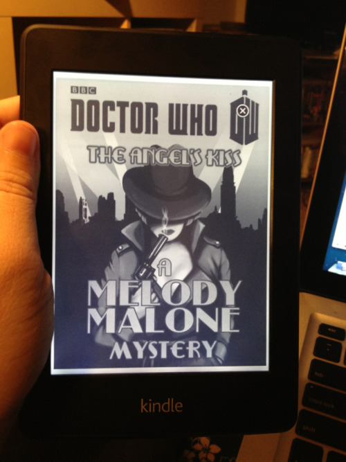 doctorwho:  Melody Malone: The Angel's Kiss tie-in novelette now available! It's an ebook which means that it's only available digitally. It's also a standalone story — (not the book from 'The Angels Take Manhattan'.) Links here: Amazon (US), Amazon (UK), eBooks.com, iBooks (Apple)  On some days, New York is one of the most beautiful places on Earth.This was one of the other days…Melody Malone, owner and sole employee of the Angel Detective Agency, has an unexpected caller. It's movie star Rock Railton, and he thinks someone is out to kill him. When he mentions the 'kiss of the Angel', she takes the case. Angels are Melody's business…At the press party for Railton's latest movie, studio owner Max Kliener invites Melody to the film set of their next blockbuster. He's obviously spotted her potential, and Melody is flattered when Kliener asks her to become a star. But the cost of fame, she'll soon discover, is greater than anyone could possibly imagine.Will Melody be able to escape Kliener's dastardly plan – before the Angels take Manhattan?  savvyliterate:  A little midnight reading! Just popped up on my Kindle!