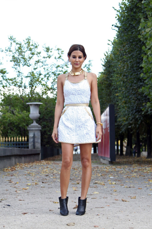 Christine Centenera in Chanel dress and boot, Celine necklace [source: vogue]