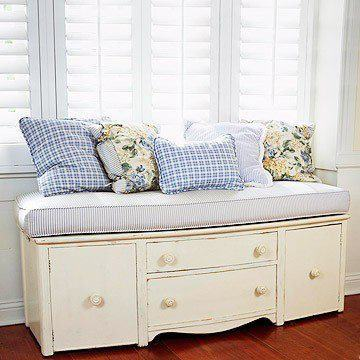 Turn an old dresser into a bench with built-in storage — remove the legs, add cushions. (via BHG)