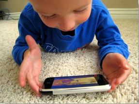 Smartphone as Child Toy on Flickr.13 Uses for an Old Smartphone. Well, the baby probably already thought it was his to begin with.