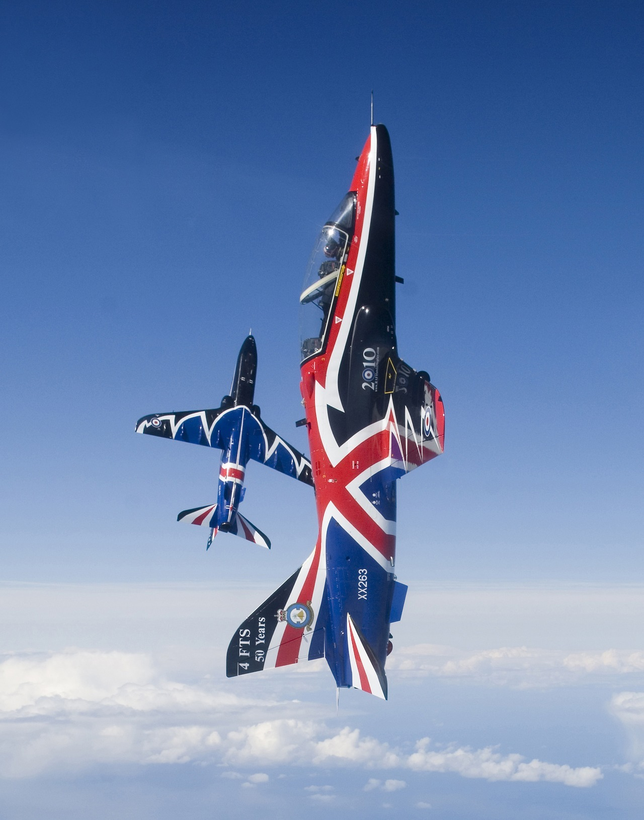 Two aerobatic Hawk T1 jet aircraft are pictured in the livery for the 2010 display season. The jets belong to 208 Squadron, Royal Air Force and are based at RAF Valley on the Isle of Anglesey, Wales.