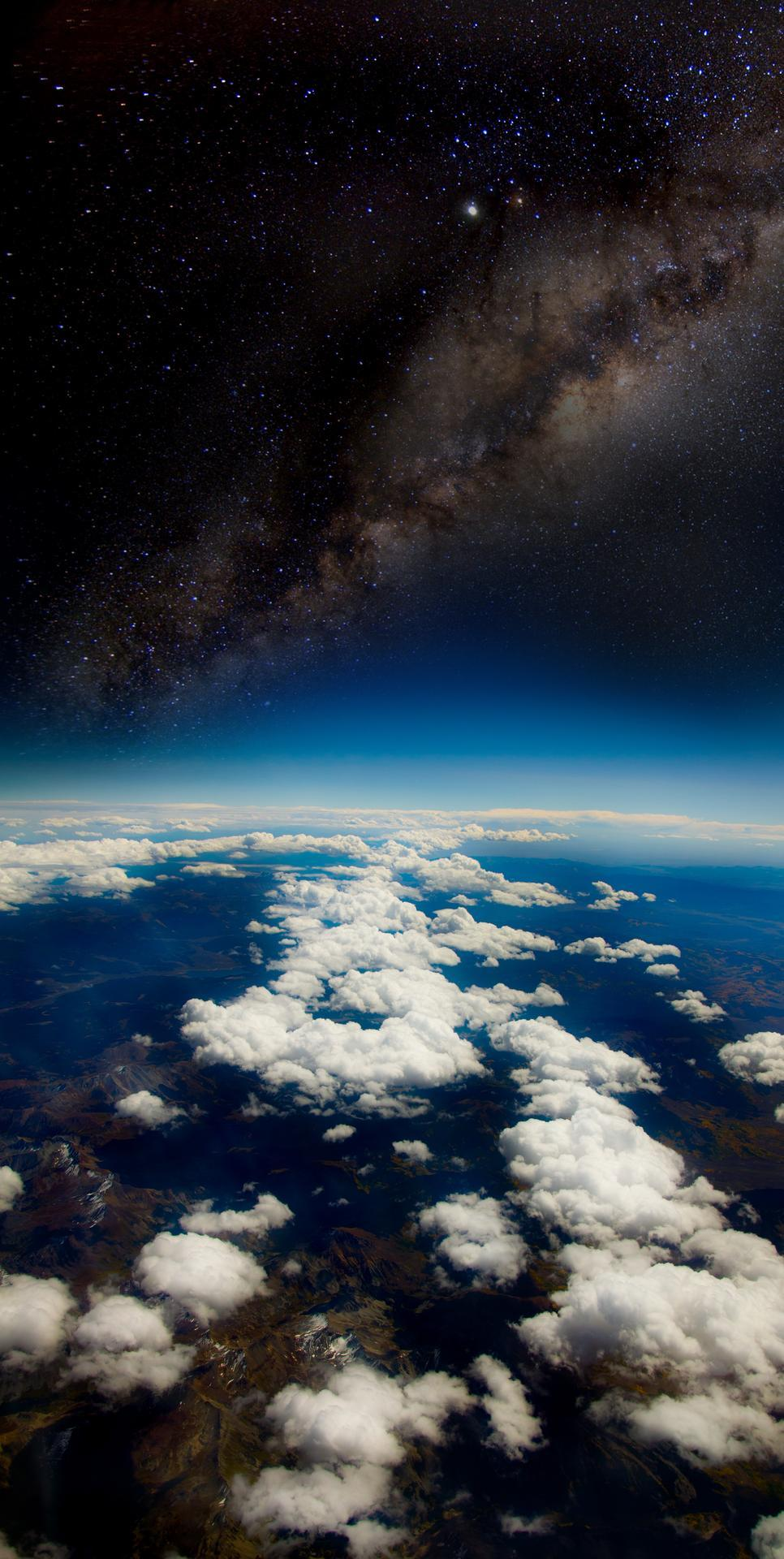opticoverload:  Earth  The picture was taken at 35,000 feet in the day time.