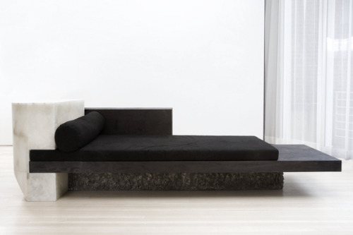 "Rick Owens - Daybed, 2010Albâtre, bronze, plywood 350 x 120 x 100 cm ""Rick Owens' singular vision as a designer fuses archaism with modernism, brutal beauty with uncompromising luxury. As in his pioneering fashion design, Owens juxtaposes the most basic materials with the most extravagant: leather and cotton in a biker jacket, for example, or alabaster and plywood in his new bedroom, Pavane for a Dead Princess. Owens' previous furniture has incorporated resin, horn, marble, bronze, leather, concrete, plywood, and cowhide. His scale shifts from broad and muscular works to lean and curved ones. Some surfaces are left untreated—rough to the touch—while others are polished or covered in fur. Owens' work in furniture references a variety of sources including 20thcentury icons, Le Corbusier, Luigi Moretti, and Donald Judd. In addition, his concept for a total domestic environment echoes those championed by Jean Michel Frank and Pierre Chareau"""