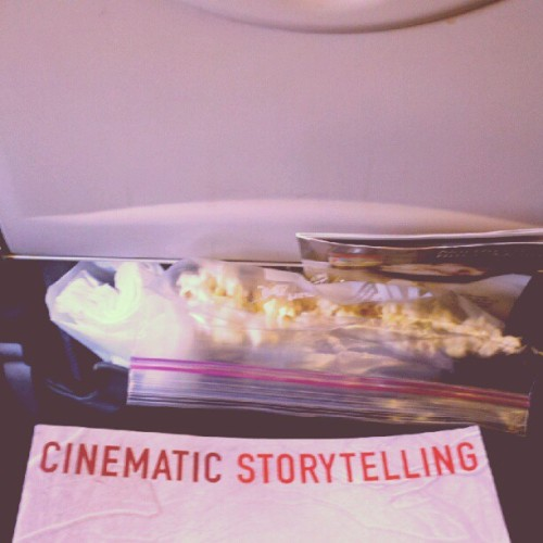 Popcorn & a good book in my seatback pocket. Bound for Seattle with @remywildandfree. (Taken with Instagram)