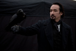 John Cusack handles a raven on the set of The Raven. http://on.fb.me/RfVeIG