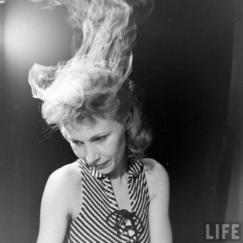 Nina Leen photographs a lady with sizzling hair