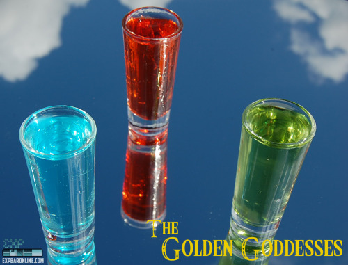 "thedrunkenmoogle:  The Golden Goddesses (The Legend of Zelda shots) Ingredients:Naru's Love-1 part UV Blue1 part Di Amore Quattro1 part Sprite Din's Fire-1 part Yukon Jack1 part Fireball Cinnamon Whisky1 part UV Cherry Farore's Wind-1 part Pineapple Rum1 part Creme de banana1 part UV Blue1 part of Rose's Lime juice Directions: For each drink, pour all ingredients into a double shot glass and mix gently. Best when served chilled.  A note from the drink's creator:  The Golden Goddesses. The most powerful creatures in the myths and folklore, they created the world and everything it holds. They bestowed three gifts upon Link to aid on his quest against Ganandorf. We created a series of shots to honor these deities that bound and built the land of Hyrule. you can either do them one after another or just pick your favorite and do it solo. Either way, we are sure you will enjoy these very well crafted shots. Naru, who poured her wisdom onto the earth and gave the spirit of law to the world. This shoot is smooth, sweet, and gives you a nice arm feeling all throughout. Din, who with her strong flaming arms, cultivated the land and created the red earth. To encapsulated this shot as best as possible, we gave it a smooth start, a little kick in the middle, and a strong fiery after punch. Farore, whose rich soul produced all life forms, who would uphold the law. With a calming neutral citrus burst to balance out the tastes and bring them all together.  ""If the heart of the one who holds the sacred triangle has all three forces in balance, that one will gain the True Force to govern all. But, if that one's heart is not in balance, the Triforce will separate into three parts: Power, Wisdom and Courage."" ~Zelda Drink created and photographed by EXPBarOnline."