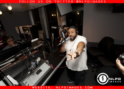 "DJ Khaled going in, introducing Ace Hood new single "" I Need Your Love"" at WEDR 99 Jamz last night."