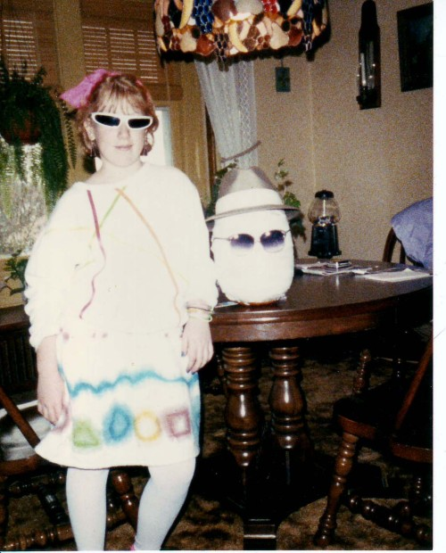 Vintage WOLH Halloween 1987: I'm not sure what I was supposed to be, but I've got a bright pink lacy bow on my head. The invisible pumpkin next to me has on a nice fedora.