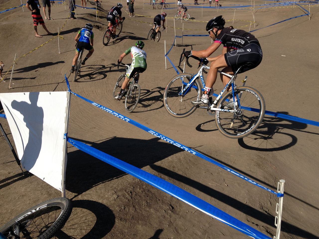 Cyclocross season kicked of in SoCal last weekend and I was in full heckle-and-beer mode under the Mudfoot tent. I am not racing myself this year as I have been focusing 100% on XC mountain bike racing, and my first race since my horrible Cat 2 finish earlier this year is this Sunday. I am a bit nervous, but mostly excited to get out there and rip out. Skinksuit is being dusted off as I type this. This photo is of my buddy Jonny Weir catching some air over the hips on the course. Cowbell!